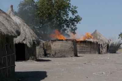 A home burns in Malakal, South Sudan