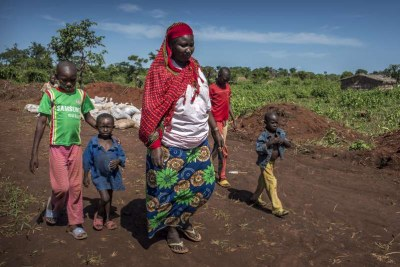A refugee family walking to see relatives in the Mbile refugee camp.