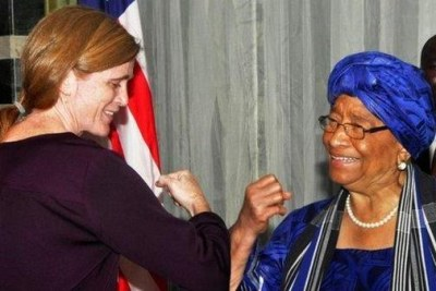 Bumping elbows—vs shaking hands—Ambassador Power with the Liberian President Sirleaf. A key part of #EbolaResponse is changing behavior.