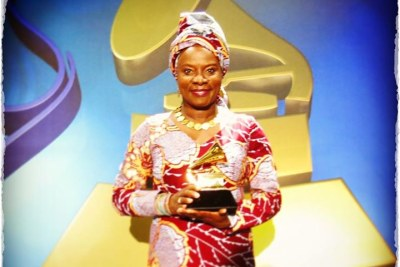 Angelique Kidjo holding her second Grammy.