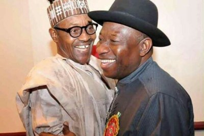 President Goodluck Jonathan and General Muhammadu Buhari in a warm embrace at the 2015 Elections Sensitization Workshop on Non-Violence in Abuja.
