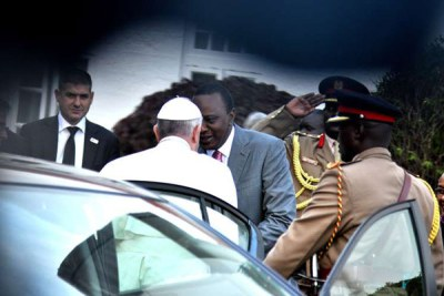 Pope Francis and President Uhuru Kenyatta shake hands at State House, Nairobi on November 25, 2015.
