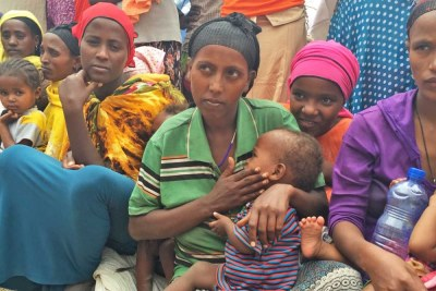 "Rahima Dadafe, a 23-year-old mother of four, is holding her youngest son, Nebiyu Jemal, age 1. She says the family is surviving on food assistance from the government, along with the special nutritious food from WFP to help baby Nebiyu recover from malnutrition. ""When the rain stopped raining, our crops failed and our livestock started dying because there was no grass for them to feed on. I had three cows. They all died. Now we are {living on} the assistance from the government."" she said."