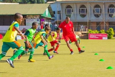 Liverpool and England legend Barnes (right) takes children through drills at Lugogo on Saturday.
