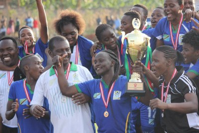 Tanzania women celebrate with the trophy after victory over Kenya gave them the regional title.