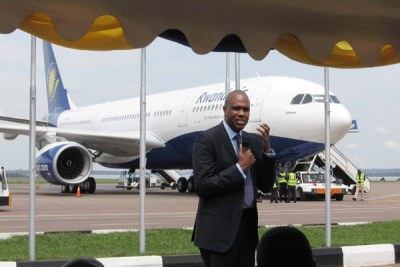 RwandAir Chief Executive Officer, John Mirenge, presenting the Ubumwe A330 airbus at Entebbe International Airport.