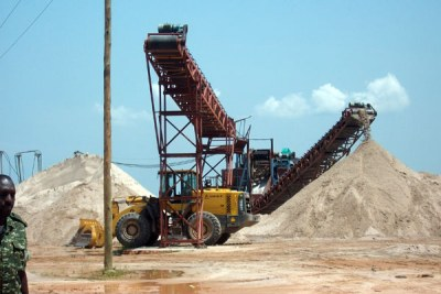 Machines excavate sand from one of the mining fields in Lwera wetland on Masaka Road. (file photo).