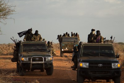 Al-Shabaab in vehicles taken from the military