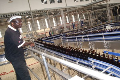 Beer bottles go through a production line (file photo).