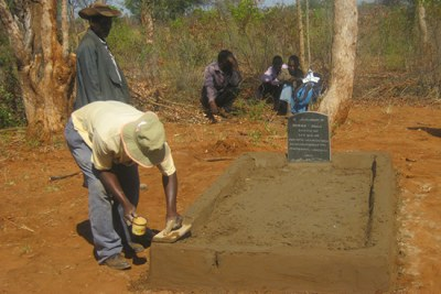 A family working on a grave of their relative who was killed during the period.