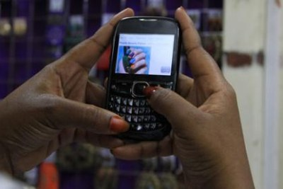 A mobile phone subscriber surfs the Internet (file photo).