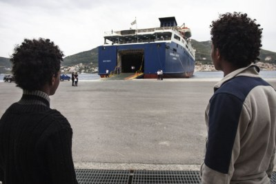 Two young Eritreans wait to board a ferry at Samos Island, Greece. Growing numbers of Eritreans are seeking asylum in Europe.