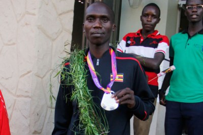 Joshua Cheptegei shows off his IAAF World Athletics Championships silver medal in Kampala.