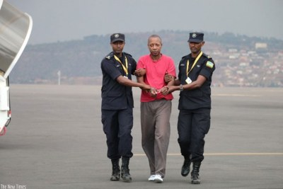 Jean Twagiramungu on arrival at Kigali International Airport.