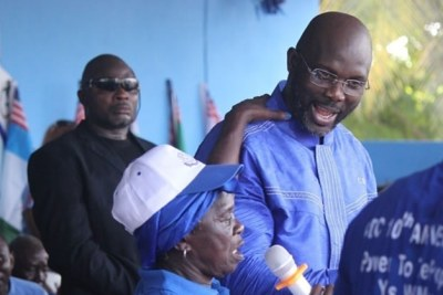 George Weah at a rally of the Congress for Democratic Change.
