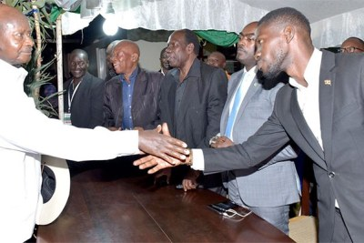 President Yoweri Museveni shakes hands with Bobi Wine (file photo).