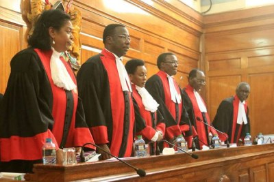 From left: Supreme Court judges Njoki Ndung'u, Smokin Wanjala, Deputy Chief Justice Philomena Mwilu, Chief Justice David Maraga, Jackton Ojwang' and Isaac Lenaola prepare to preside over the election petition case at the Supreme Court on November 16, 2017.