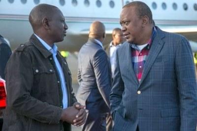 President Uhuru Kenyatta is greeted by Deputy President William Ruto (file photo).