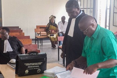 2nd Lt. Henry Jean-Claude Seyoboka in court with his new lawyer Théophile Kazineza.
