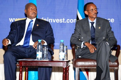 President Yoweri Museveni with his Rwandan counterpart Paul Kagame, right,  at the East African Investment Conference in Kigali, Rwanda on June 26, 2008.