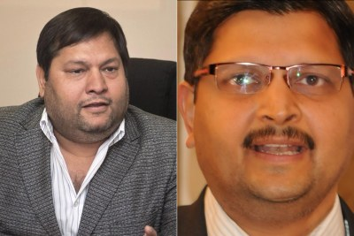 Gauche: Ajay Gupta. Droite: Atul Gupta.