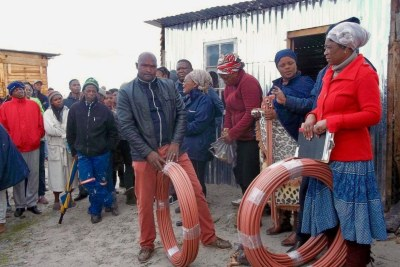 Residents of Siyahlala informal settlement in Khayelitsha prepare to install their own water taps.