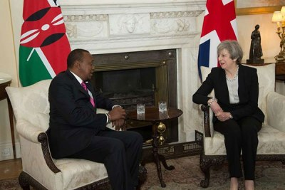 Kenya's President Uhuru Kenyatta (left) talks with United Kingdom Prime Minister Theresa May at 10 Downing Street in London on May 11, 2017.
