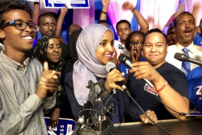 Ilhan Omar addresses supporters after her historic primary election victory to represent Minnesota's 5th District in the U.S. Congress in Minneapolis