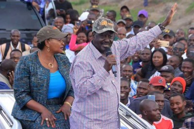 Nasa leader Raila Odinga addresses supporters at Mlolongo in the company of Machakos governor candidate in the last elections Wavinya Ndeti (file photo).