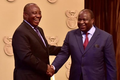 President Cyril Ramaphosa congratulates new finance minister Tito Mboweni after his swearing-in.