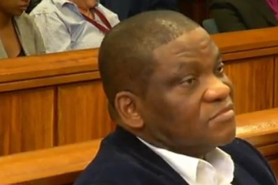 Video screenshot of Nigerian pastor Timothy Omotoso in the Eastern Cape High Court in Port Elizabeth.