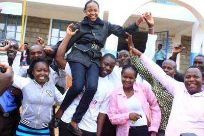 Parents and teachers of Imperial Primary in Kisii town celebrate with Gloria Kemunto Ogochi who scored 435 marks in KCPE on November 19, 2018.