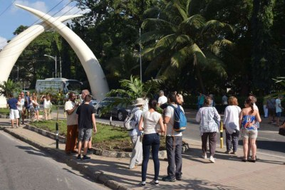 A group of tourists take photos at the iconic Tusks along Moi Avenue in Mombasa's CBD.