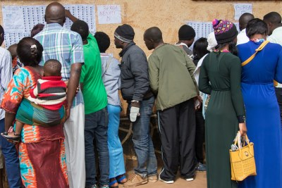 Voters look for their names in the lists during Presidential and Legislative elections in in the Democratic Republic of the Congo (30 December 2018).