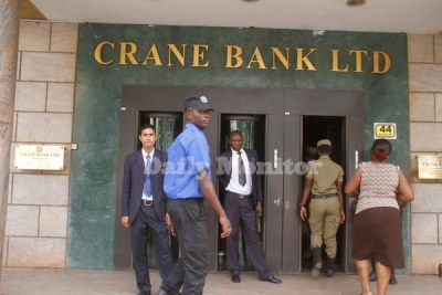 Police officers enter Crane Bank main branch in Kampala to beef-up security shortly after Governor Emmanuel Mutebile announced that BoU had taken over management of the bank.