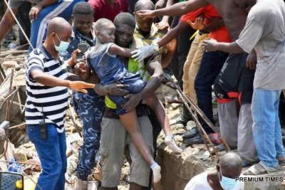 A child being rescued from the scene of a building, which collapsed at Itafaji on the Lagos Island on Wednesday.