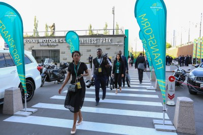 African journalists walk to their next interview at the Afreximbank meetings in Moscow.