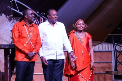 President Uhuru Kenyatta with the newly weds Governor Anne Mumbi and Kamotho Waiganjo during their traditional wedding ceremony.