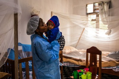 A caregiver with the seven-month-old baby of a woman who died of Ebola in North Kivu,