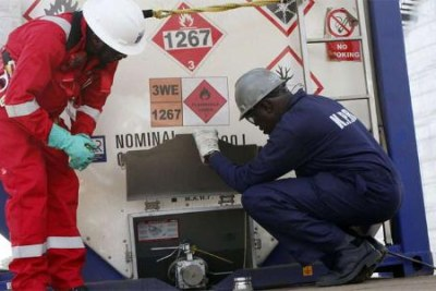 Tullow Oil workers offload crude (file photo).