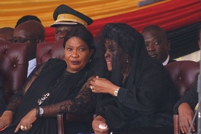 First Lady Auxillia Mnangagwa and former First Lady Grace Mugabe during the funeral service for Robert Mugabe.