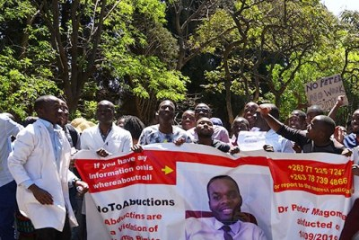 Zimbabwean health workers protest the disappearance of missing medical doctor and union leader Peter Magombeyi.