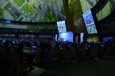 Climate activist Greta Thunberg, on screens and right at stage, Climate Activist, speaks at the opening of the UN Climate Action Summit 2019. With her on the stage are, from left to right: Secretary-General António Guterres; Anurag Saha Roy, Winner of the Summer of Solutions Pitch Competition; and Paloma Costa Oliveira, Lawyer and Climate Activist.