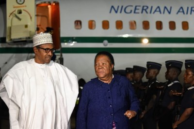 South Africa's Minister of International Relations and Cooperation Naledi Pandor greets Nigerian President Muhammadu Buhari as he arrives in South Africa for a state visit, October 2, 2019.
