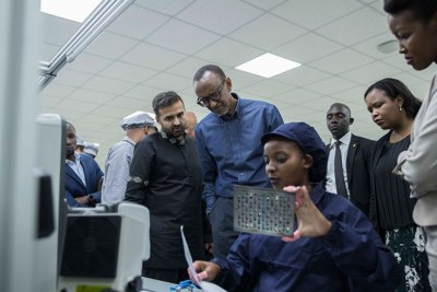 President Kagame together with other officials (L-R); Ashish Thakkar, the CEO of the Mara Group, Clare Akamanzi, the chief executive of Rwanda Development Board and the Minister for ICT and Innovation Paula Ingabire inspect one of the production units of Mara Phones.