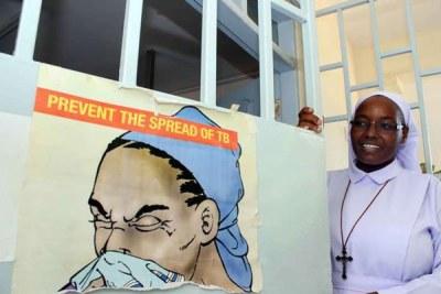 Sister Veronicah Wanjiru of Mbungoni Catholic Clinic in Mombasa displays information about tuberculosis (file photo).