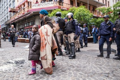 Refugees and police in Cape Town (file photo).