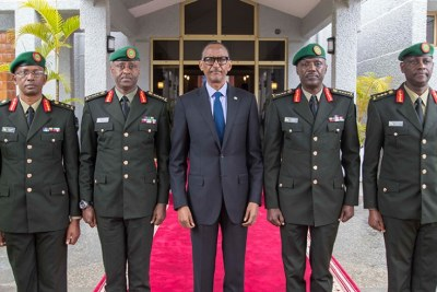 President Paul Kagame, the Commander in Chief of Rwanda Defence Force (RDF), poses with newly appointed top military leaders, Gen Jean-Bosco Kazura, RDF Chief of Defence Staff (2nd left); Gen Fred Ibingira, Chief of Staff, Reserve Force (2nd right); Lt. Gen Jack Musemakweli, Inspector General of RDF (right); and Maj Gen Innocent Kabandana, the deputy Reserve Force Chief of Staff (left), after they were sworn-in at the Parliamentary Builidings, Kimihurura.