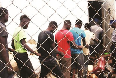 Suspected machete gang members being led into a holding cell at Mazowe Police Camp (file photo).