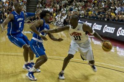 Kobe Bryant, in white, dribbles against players from the Dominican Republic during a pre-Olympic exhibition game on July 12, 2012, at the Thomas & Mack Center in Las Vegas.